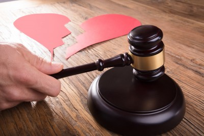 Divorce Judge With Broken Heart At Desk Hitting Gavel